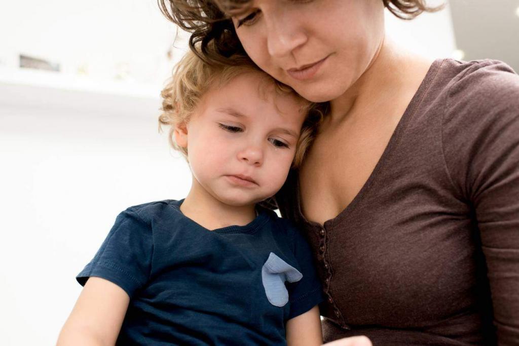 parent comforting upset child