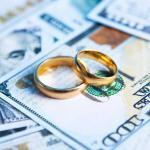 wedding rings on top of money